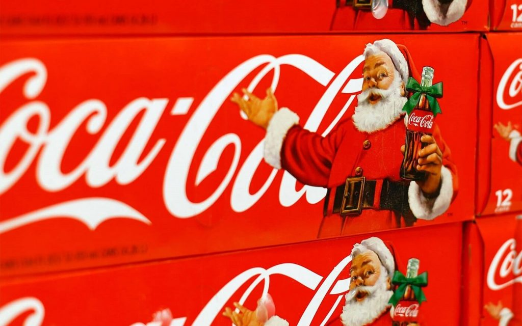 person as a brand coca cola santa claus