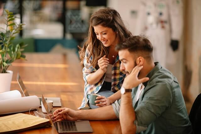 couple reviewing information on computer medium
