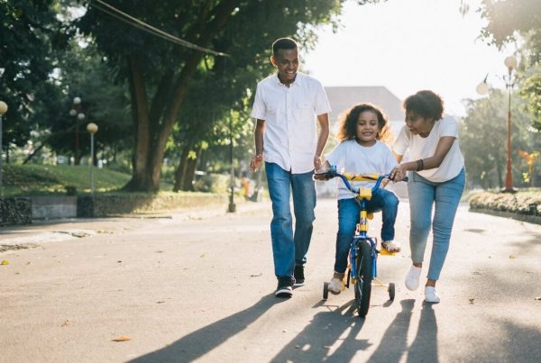 fabric insurance will family learning to ride bike