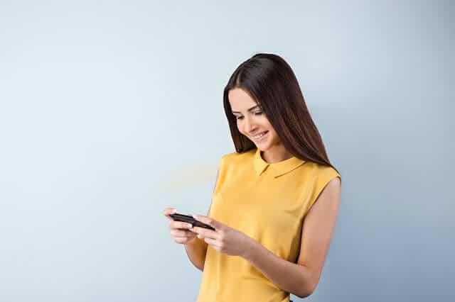 female investor using smart phone app medium