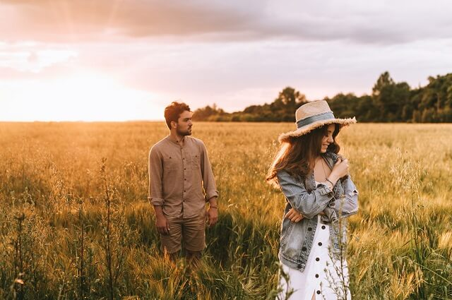 happy couple in field medium