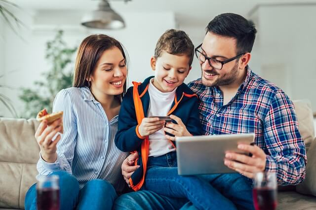 happy family using card to order online