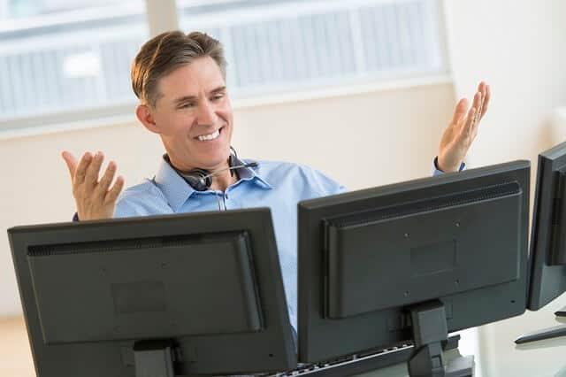 investor looking at monitors medium