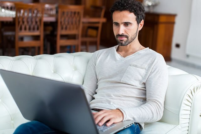 man reviewing information on computer medium