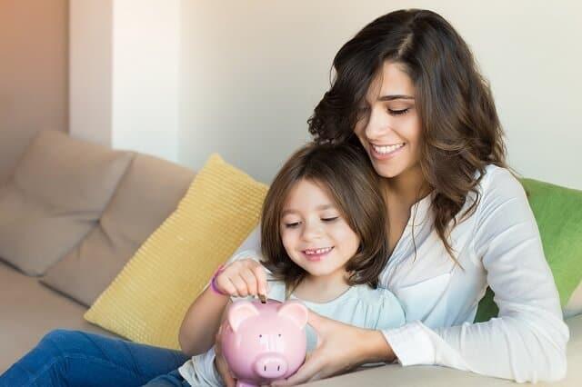mother and daughter saving money medium