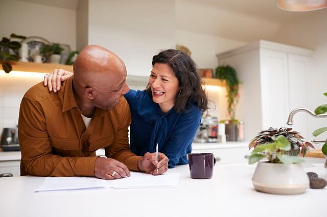 older couple reviewing finances laughing medium