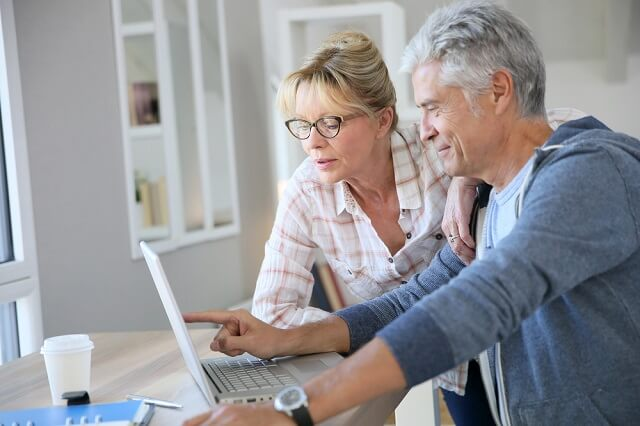 older couple reviewing financial information medium