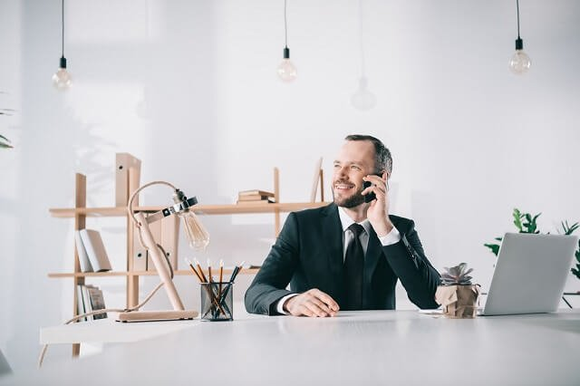 successful man on phone medium