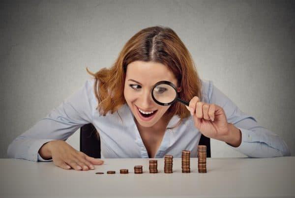 woman examining penny stocks