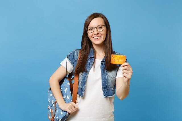 young student posing with a credit card