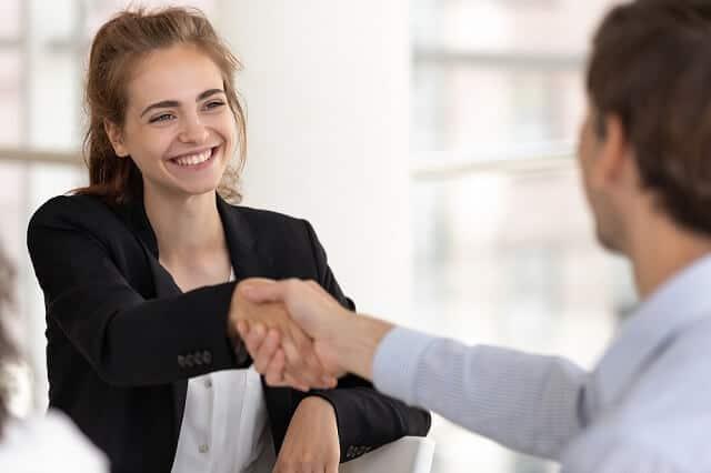 young woman and man shaking hands medium
