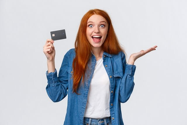 young woman excited about getting a credit card