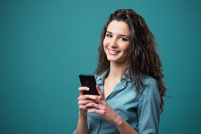 young woman investing on smartphone